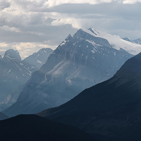 Dramatic snowy mountain landscape along the Icefields Parkway, Canada