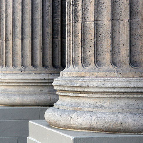 Row of the base of classic architectural stone columns